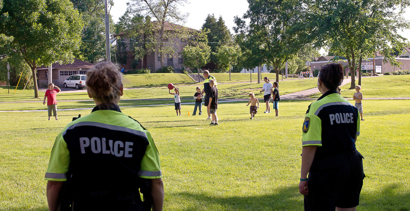 6-29-11_Summertime_by_George_Police_work_with_kids_LR_PE10_g_
